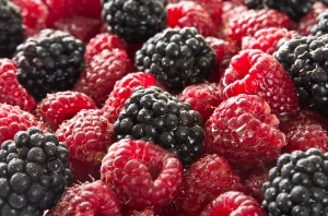 Stack of raspberry and blackberry as background